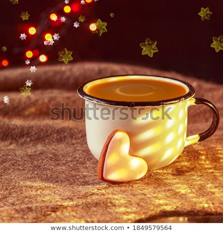 Freshly baked heart-shaped cookie and cappuccino Stock photo © avdveen