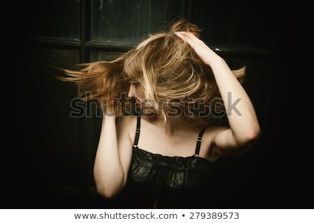 Young woman with blown hairs Stock photo © grafvision