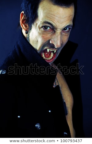 Male vampire showing teeth Stock photo © sumners