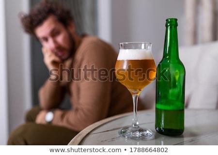 Sad beer drinker Stock photo © stevanovicigor