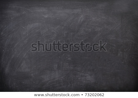 Empty blank black chalkboard with chalk traces Stock photo © dashapetrenko