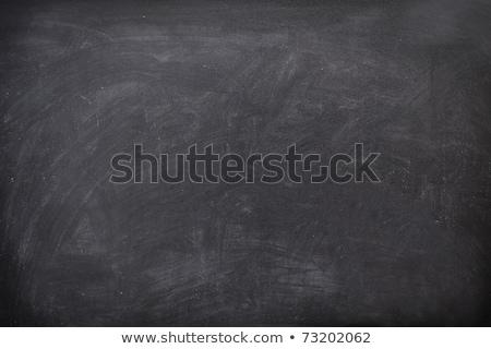 Empty blank black chalkboard with chalk traces Stock photo © dashapetrenko