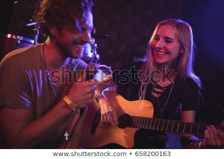 Alegre sonriendo femenino cantante micrófono Foto stock © wavebreak_media