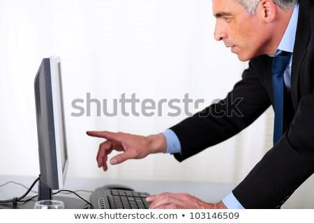 Elegancki człowiek biznesu wskazując komputera portret hiszpańskie Zdjęcia stock © pablocalvog