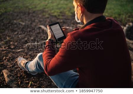 ebook · dispositivo · cubrir · aislado · blanco · libro - foto stock © raywoo