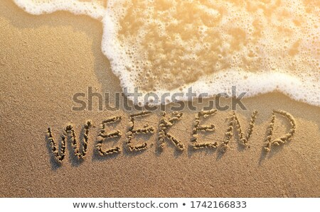 hand written in the sand Stock photo © morrbyte