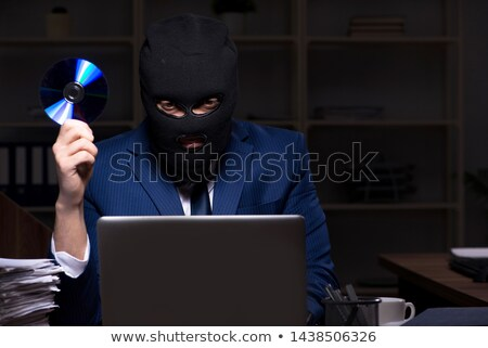 Businessman stealing compact disk Stock photo © wavebreak_media