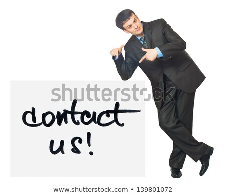 young businessman points on a card contact us on a white stock photo © vlad_star