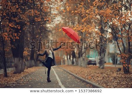 Güzel bir kadın kırmızı şemsiye güzel genç kadın yeşil Stok fotoğraf © stepstock