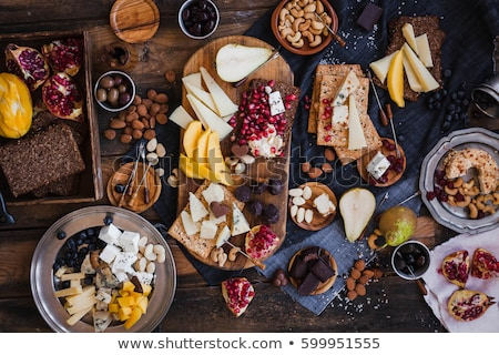 gourmet snack foods platter on wooden table Stock photo © travelphotography