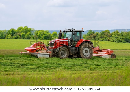 farmer with mowing machine mowing grass stock photo © compuinfoto