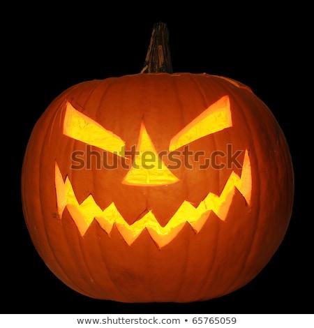 Halloween pumpkin jack-o-lantern candle lit, isolated on black Stock photo © vlad_star