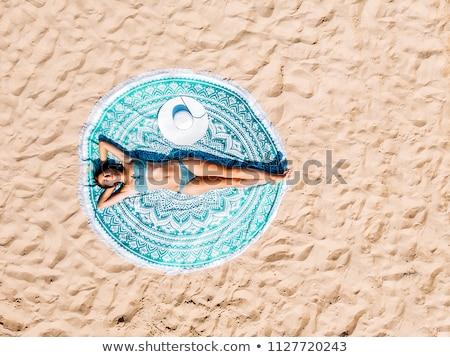 woman in bikini top lying on beach towel stock photo © andreypopov