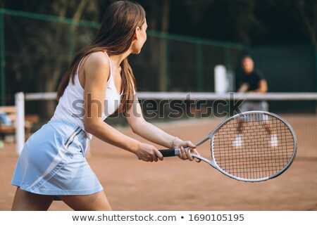 Happy Tennis Player Holding Racquet And Ball Stock photo © AndreyPopov