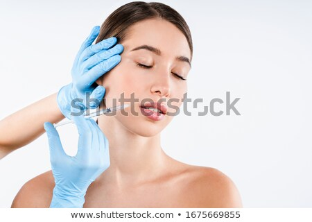 portrait of a young caucasian woman doctor with a syringe in hand Stock photo © ambro