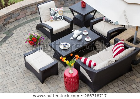 A relaxing tea break in a deep seating patio set Stock photo © ozgur