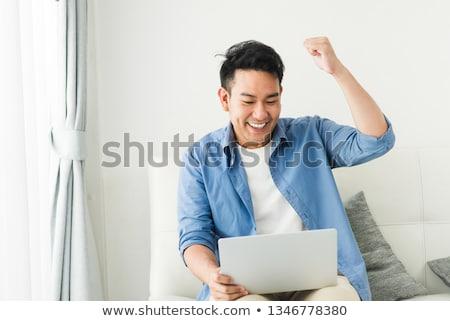 Glücklich Jubel Geschäftsmann Arme weiß Bildschirm Stock foto © wavebreak_media