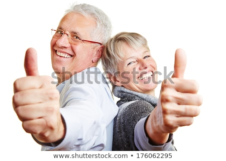 Happy elderly couple with a thumbs-up Stock photo © ambro