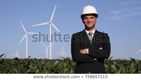 Business man near wind farm Stock photo © fuzzbones0