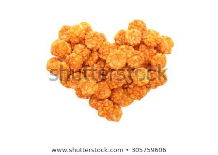 Chilli rice crackers in a heart shape Stock photo © sarahdoow