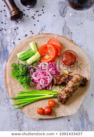 Juicy roast chicken with vegetables and ketchup with a glass of wine and bread . Served on porcelain Stock photo © mcherevan