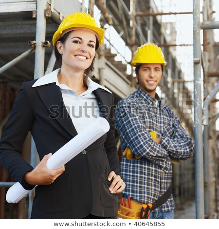 two attractive women on construction site stock photo © aikon