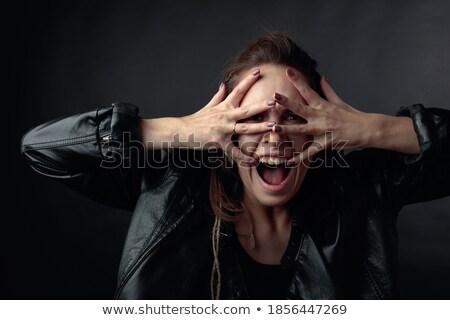 Bastante mulher jovem coberto cara preto jaqueta Foto stock © deandrobot