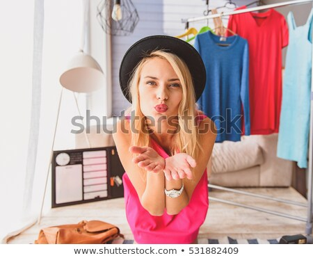 young woman sending a kiss to the camera Stock photo © Giulio_Fornasar