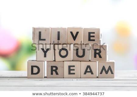Live your dream text on wooden table Stock photo © fuzzbones0
