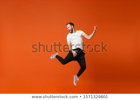 man in jumping action pose stock photo © istanbul2009