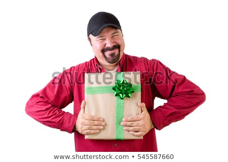 Excited man in baseball cap with wrapped present Stock photo © ozgur