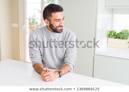 handsome casual man looking to side and thinking stock photo © feedough