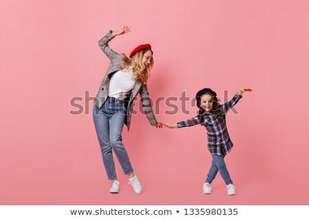 Feliz encantador little girl camisas Foto stock © deandrobot