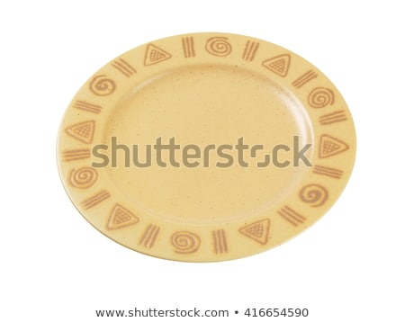 Handmade pottery plate with decorated rim Stock photo © Digifoodstock