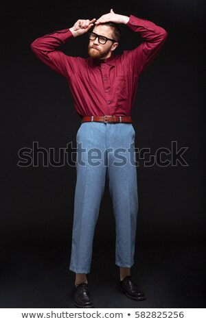 Stock photo: Vertical image of Male nerd combing his hair