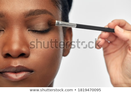 Woman applying shadows  in beauty concept Stock photo © Elnur