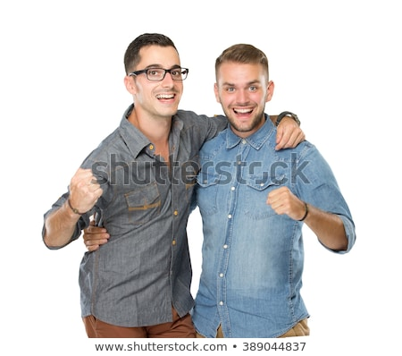 Two beautiful friends pose on white background stock photo © tekso