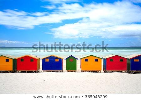 wooden colorful huts on sand stock photo © wavebreak_media