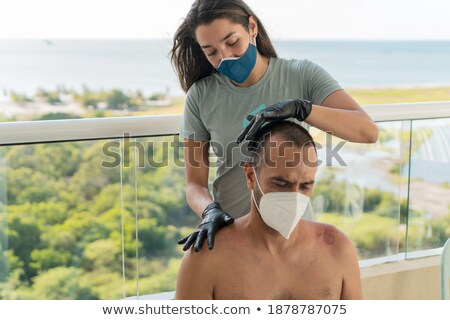 Physiotherapist assisting senior woman in performing exercise with resistance band Stock photo © wavebreak_media