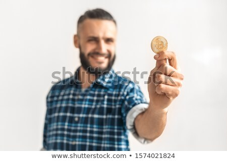 Smiling bearded man in checkered shirt holding money Stock photo © deandrobot