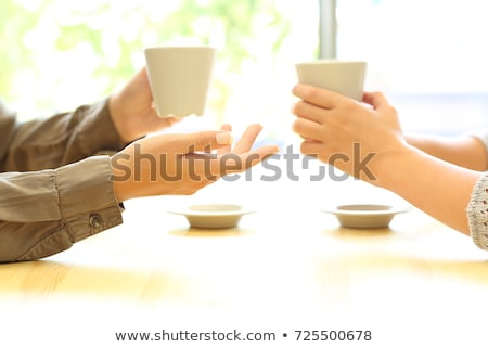 two woman hands up stock photo © julenochek