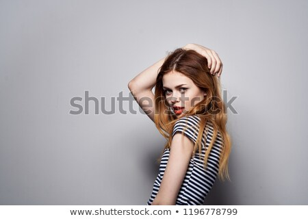 rear view of woman showing sign okay stock photo © artjazz