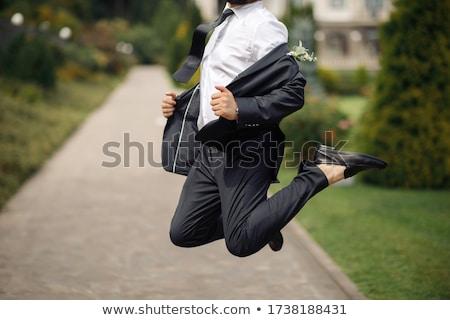 successful caucasian groom jumping stock photo © rastudio