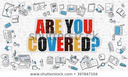 are you covered concept multicolor on white brickwall stock photo © tashatuvango
