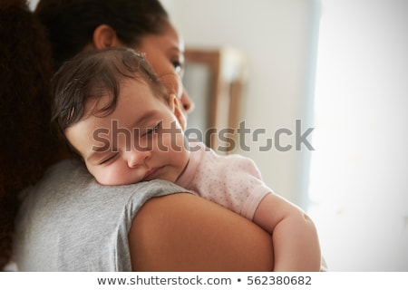 smiling mother with sleeping baby Stock photo © IS2