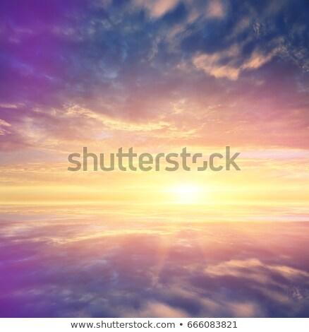 Sereno puesta de sol cielo invierno congelado lago Foto stock © Juhku