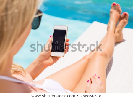 hand holding smartphone by poolside stock photo © stevanovicigor
