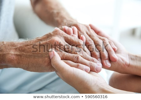 Stock photo: woman holding senior man's hand