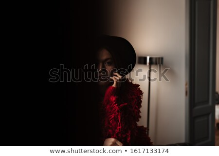 girl hiding behind wall, laughing Stock photo © IS2