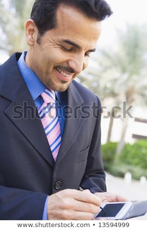 biznesmen · pda · na · zewnątrz · człowiek · technologii · osoby - zdjęcia stock © monkey_business